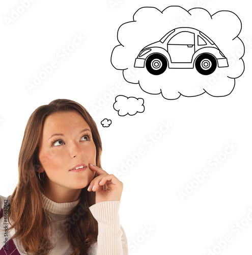 Girl dreaming about owning a car (isolated)