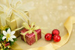 Christmas Presents with gold ribbon and red baubles.