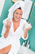 Happy woman enjoying spa treatment hotel bathroom
