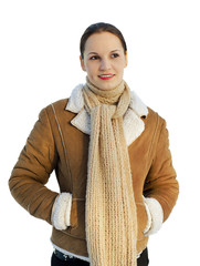 Smiling woman wearing winter clothing. Isolated over white backg