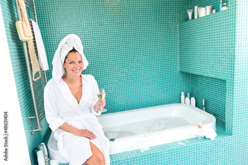 Happy woman relaxing bathroom spa wellbeing hotel