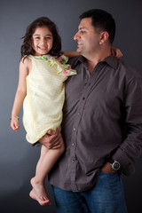 Happy East Indian man with his daughter