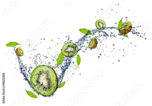 Fresh kiwis in water splash on white background