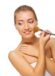 Young healthy girl with makeup brush