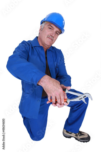 Workman with an adjustable spanner