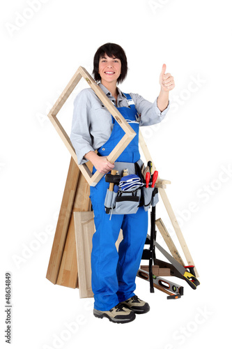 Female carpenter holding wooden frame