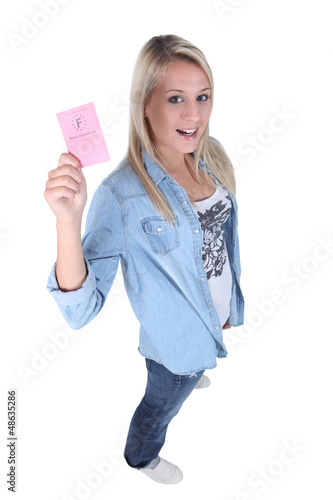 young blonde showing driving license