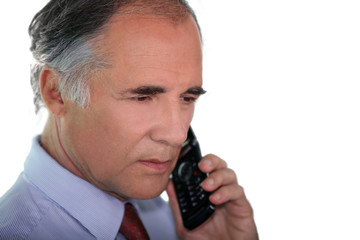 Senior businessman using a cellphone