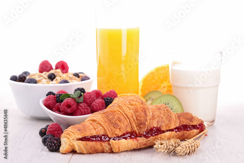 breakfast with croissant, juice and fruits