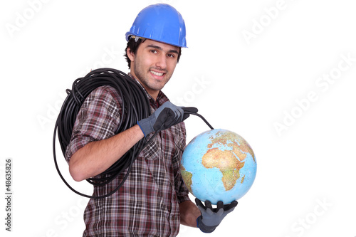 An electrician plugging a wire in a globe.