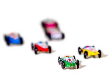 Colorful toy races cars on white background