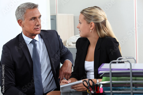 Man and woman flirting in office