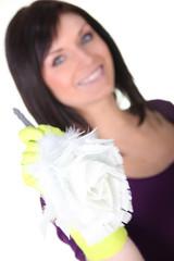 Brunette holding a duster