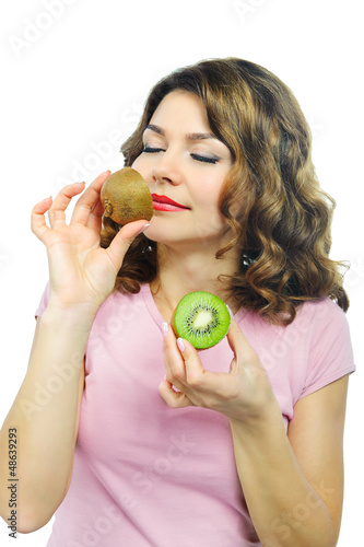 Beuatiful young girl smelling kiwi isolated on white
