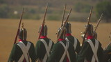 During reenactment of a combat of the year 1812.  Slow motion.