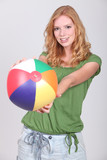Teenage girl with inflatable beach ball
