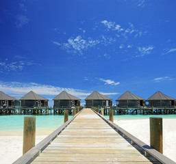 View of water villas resort on a Maldives island