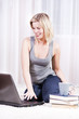 Beautiful blonde woman in her apartment over the internet.