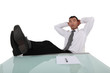 businessman having a break with legs on table