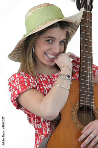 Playful girl holding guitar