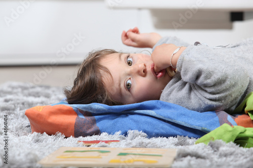 kid lying on the floor
