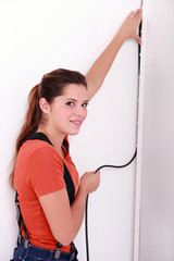 Woman placing electrical cable