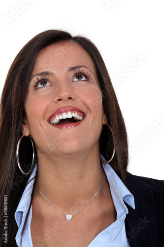 Businesswoman with look of  amazement on face