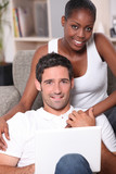 Couple sitting on sofa gray