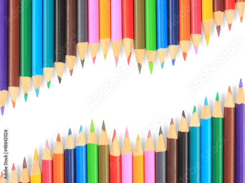 Close up of color pencils with different color over white backgr