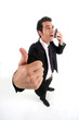 Businessman talking on phone and giving the thumb's up