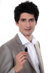 Businessman holding USB stick