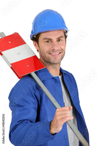 Builder with road sign