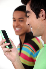 Teen male teenagers looking at text message