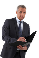 Businessman writing in a folder