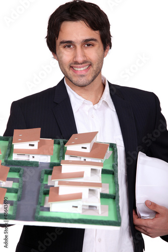 young architect holding a model of a building