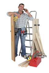 Handyman talking to a supplier