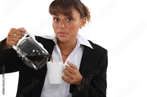 woman in a suit drinking a cup of coffee