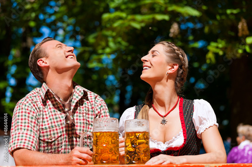 Happy Couple sitting in Beer garden