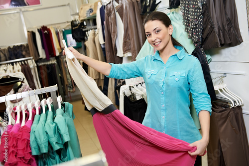 Young woman at apparel clothes shopping