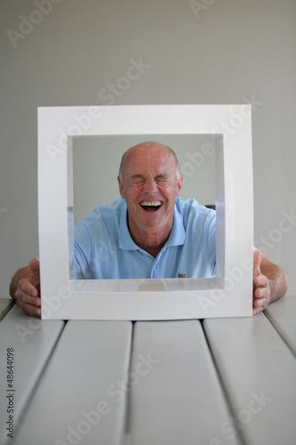 senior looking through a picture frame