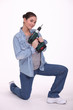 Woman with a cordless drill/screwdriver