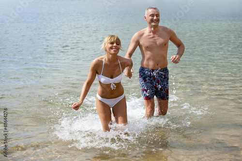 Couple running in the sea