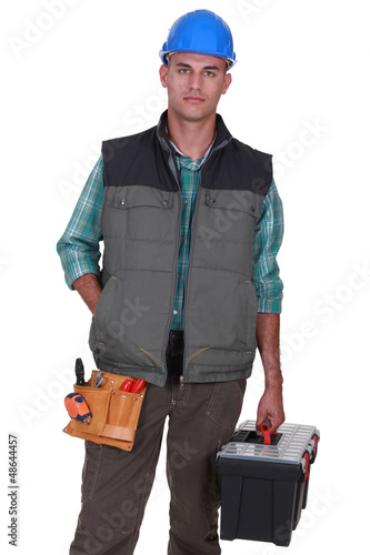 Bald worker holding tool box