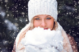 woman holding snow on hands