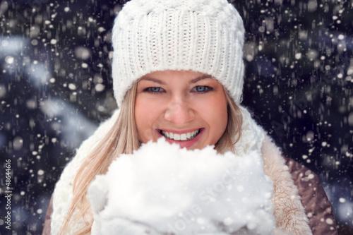 happy woman holding snow