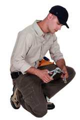 Plumber with a pair of grips