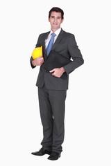 Smart businessman holding folder
