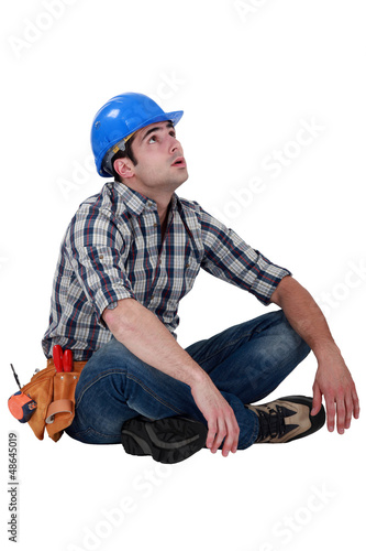 Tired builder taking well earned break