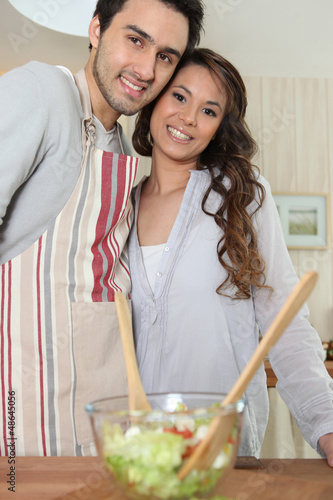 Couple preparing meal in kitchen