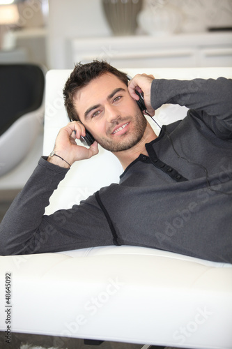 man listening to music on sofa